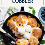 Overhead image of southern peach blueberry cobbler recipe with text title box at top