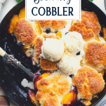 Close overhead image of easy blueberry peach cobbler with text title overlay
