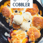 Close overhead image of Southern peach blueberry cobbler with text title overlay