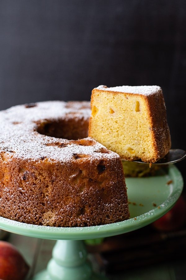 Serving a slice of southern peach pound cake with a server
