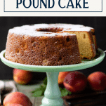 Close up side shot of peach pound cake on a stand with text title box at top