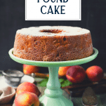 Peach pound cake on a stand with text title overlay