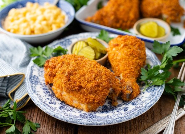 Horizontal shot of a plate of oven fried chicken thighs and drumsticks
