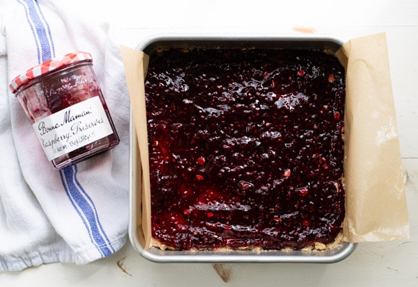 Layer of raspberry jam on bars