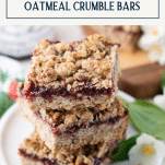 Stack of buttery raspberry crumble bars with text title box at top