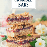 Close up shot of a stack of raspberry oatmeal bars with text title overlay