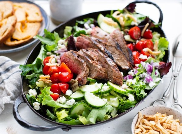 Horizontal shot of a pan of grilled steak salad with blue cheese