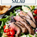 Close up shot of the best steak salad recipe with text title box at top