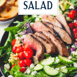 Close up shot of flank steak salad with text title overlay