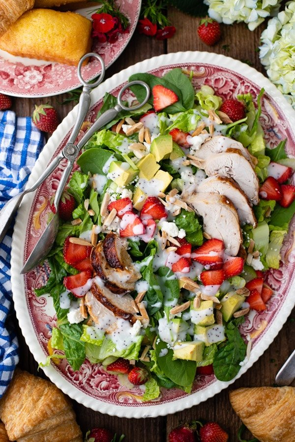 Overhead shot of a platter of strawberry chicken salad with poppy seed dressing