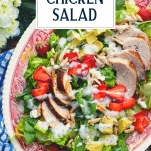 Overhead shot of strawberry chicken salad with poppy seed dressing and text title overlay