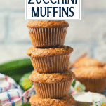 Stack of zucchini muffins with text title overlay
