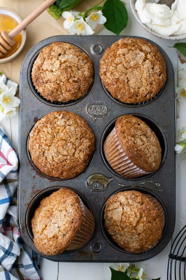 Close overhead image of the best zucchini muffin recipe in a muffin tin