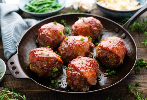Horizontal shot of a pan of mini bacon wrapped meatloaf