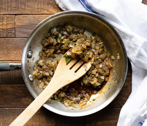 Sauteed onions and herbs in a skillet