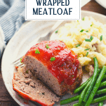 Plate of mini bacon wrapped meatloaf with text title overlay