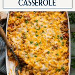 Beef noodle casserole on a green table with text title box at top