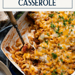 Overhead shot of a casserole dish full of cheesy ground beef and noodles