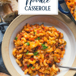 Overhead shot of a bowl of beef noodle casserole with text title overlay
