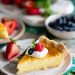 Slice of homemade buttermilk pie with a fork on a plate