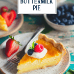 Lemon buttermilk pie on a plate with text title overlay