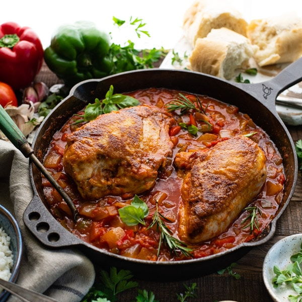 Square image of the best chicken cacciatore recipe in a cast iron skillet