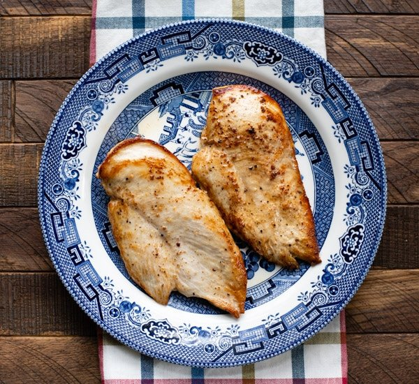 Browned chicken cutlets on a plate