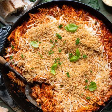 Overhead image of a chicken parmesan casserole with panko breadcrumbs on top