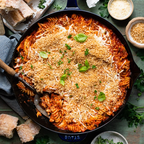 Square overhead shot of a pan of rotisserie chicken parmesan casserole