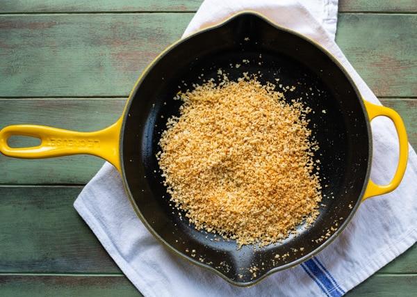 Toasted garlic panko breadcrumbs in a cast iron skillet