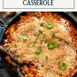 Skillet of chicken parmesan casserole with panko breadcrumbs and text title box at top