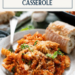 Side shot of a plate of chicken parmesan casserole with text title box at top