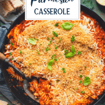 Overhead image of a pan of baked chicken parmesan casserole with text title overlay