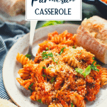 Side shot of a plate of chicken parmesan casserole with pasta and text title overlay