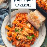 Overhead shot of a plate of chicken parmesan casserole with text title overlay