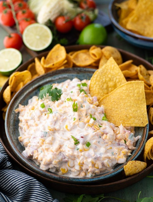 Side shot of cold corn dip with rotel and fritos