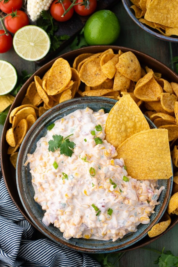 Overhead shot of summer corn dip recipe served with a side of chips