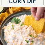 Side shot of a bowl of Mexican corn dip with text title box at top