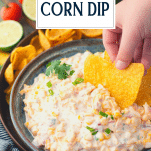 Side shot of a bowl of corn dip with text title overlay