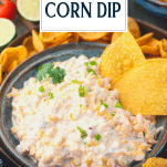 Tortilla chips in a bowl of corn dip with rotel and text title overlay
