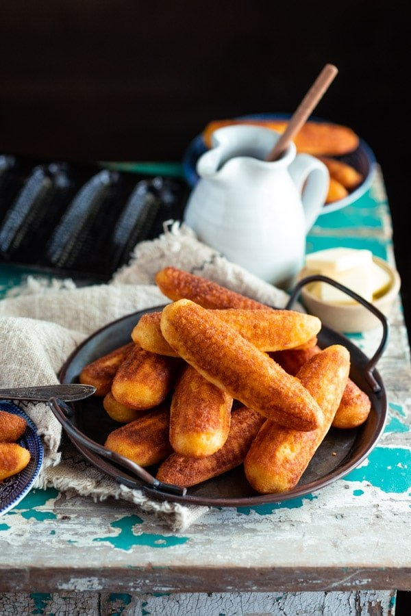 Rustic table with cornbread sticks and a cast iron corn stick pan