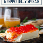 Close up side shot of cream cheese and pepper jelly crackers with text title box at top