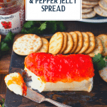 Side shot of pepper jelly with cream cheese and crackers and text title overlay