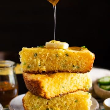 Drizzling honey on Mexican cornbread