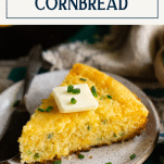 Slice of mexican cornbread on a white plate with text title box at top