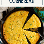 Overhead shot of a pan of jalapeno cheddar cornbread with text title box at top