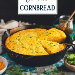 Side shot of a skillet of mexican cornbread with text title overlay