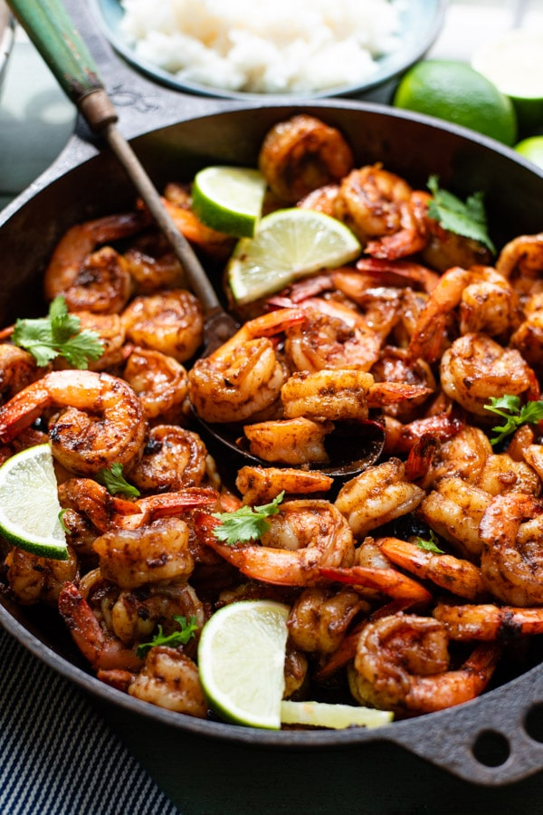 Close up side shot of Mexican shrimp in a cast iron skillet