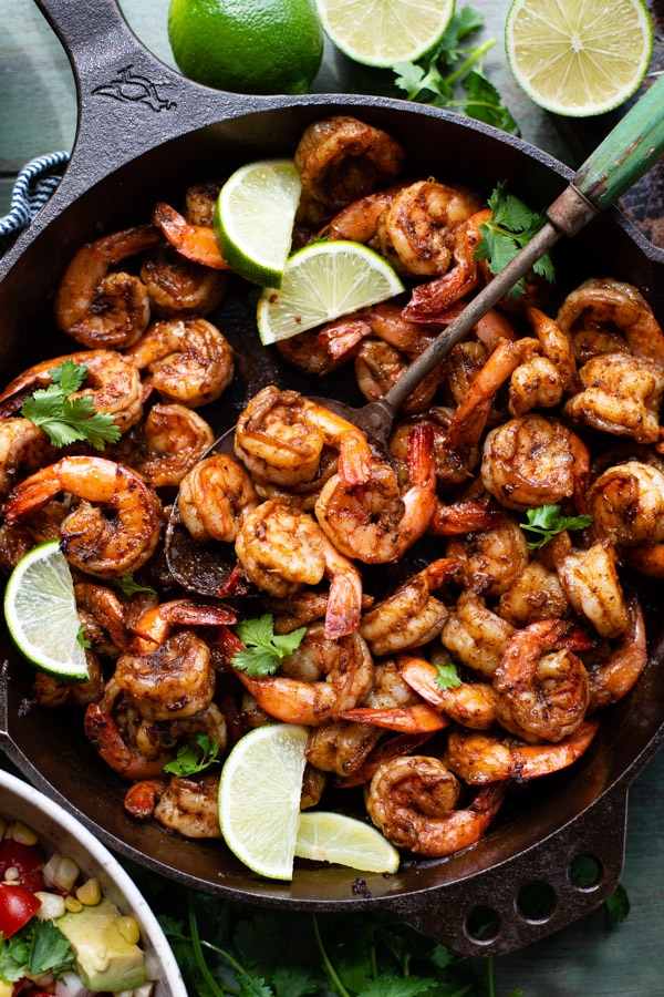 Overhead close up image of a cast iron skillet full of Mexican shrimp