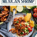 Mexican inspired spread of shrimp tacos and salsa with text title box at top